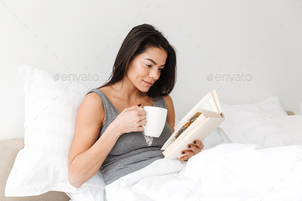 Portrait of pleased peaceful woman with long brown hair resting - Stock Photo - Images
