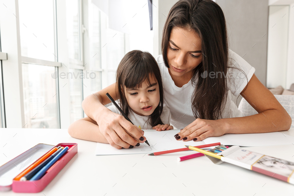 Image of beautiful people woman and child sitting at table in fl - Stock Photo - Images