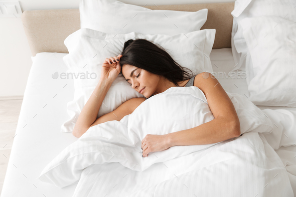 Portrait of peaceful beautiful woman sleeping alone at home in b - Stock Photo - Images