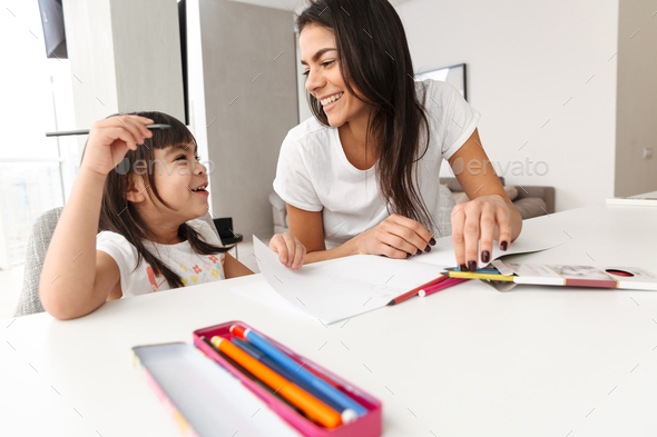 Portrait of smiling family mother and child spending time togeth - Stock Photo - Images
