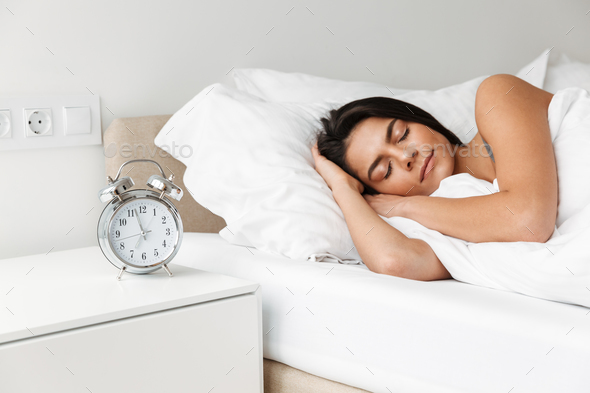 Portrait of beautiful young woman sleeping in bed at bedroom, wi - Stock Photo - Images