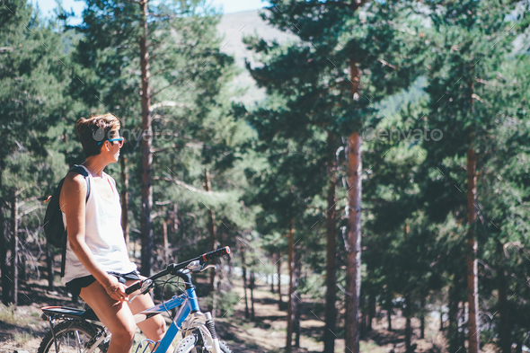 Girl with bicycle at the mountain - Stock Photo - Images