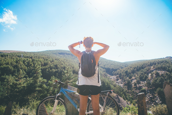 Sporty woman admires the view - Stock Photo - Images