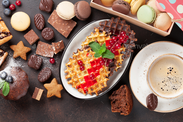 Coffee, sweets and waffles with berries - Stock Photo - Images