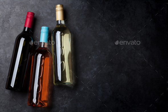 Red, pink and white wine bottles - Stock Photo - Images