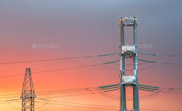 High voltage power transmission line on sunset  - Stock Photo - Images