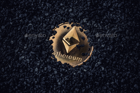 Gold coin with cryptocurrency logo - Stock Photo - Images