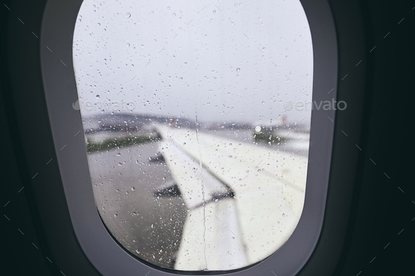 Airplane window during rain - Stock Photo - Images