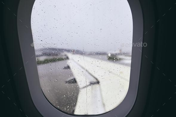 Airplane window during rain - Stock Photo - Images