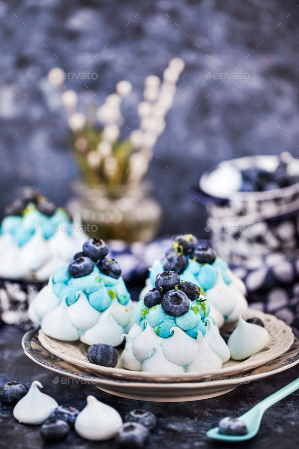 Delicious blueberry Pavlova meringue cakes decorated with cream - Stock Photo - Images