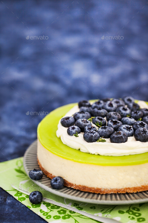 Delicious key lime cheesecake decorated with fresh blueberries - Stock Photo - Images