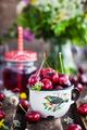 Fresh wet cherry in enamel metal mug - PhotoDune Item for Sale