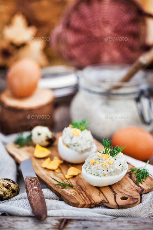 Eggs stuffed with herring creamy pate on wooden rustic backgroun - Stock Photo - Images