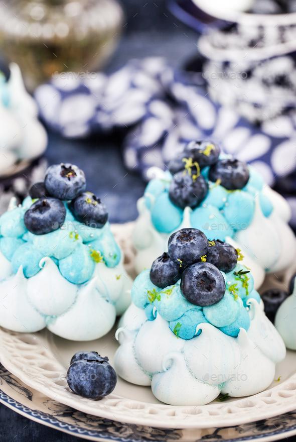 Delicious blueberry Pavlova meringue cakes decorated with cream - Stock Photo - Images