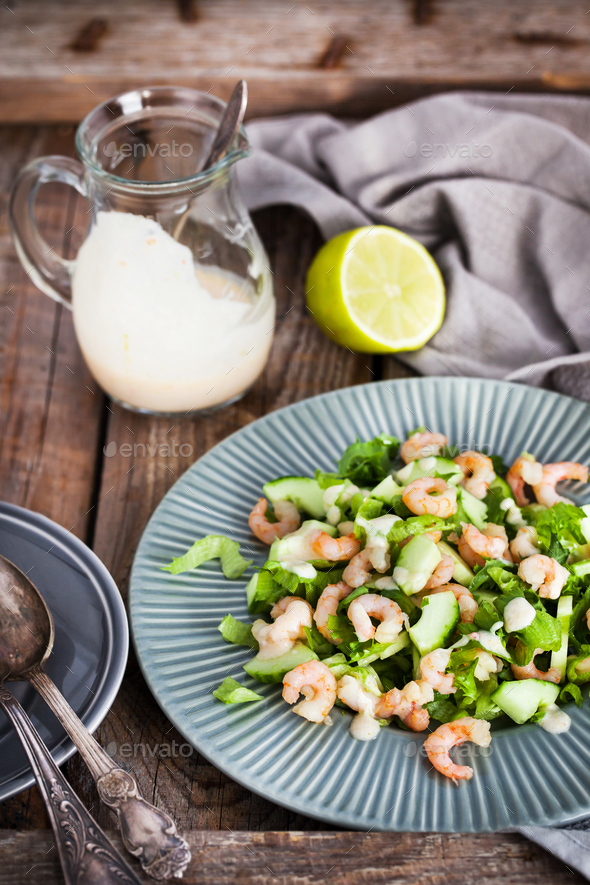 Shrimps, cucumber and lettuce salad with yogurt dressing - Stock Photo - Images
