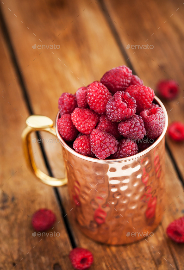Fresh ripe raspberries in a copper mug - Stock Photo - Images