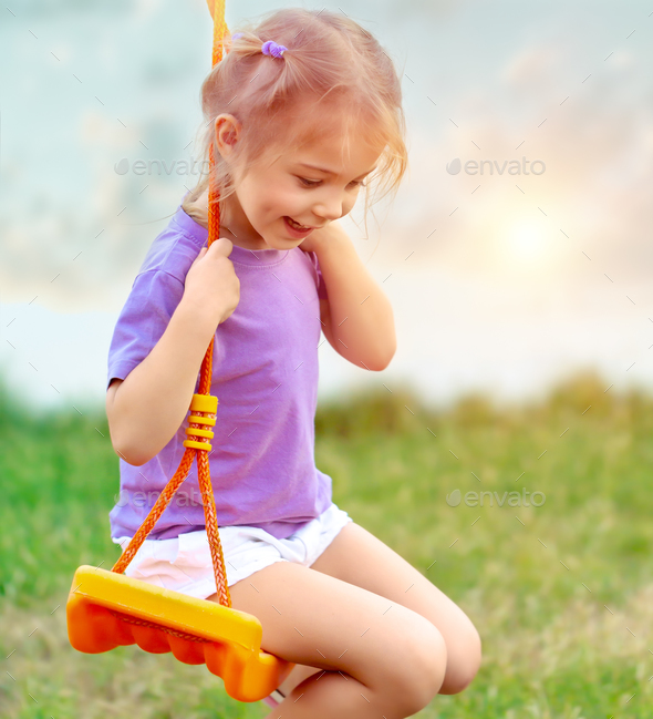 Cute baby girl on the swing - Stock Photo - Images