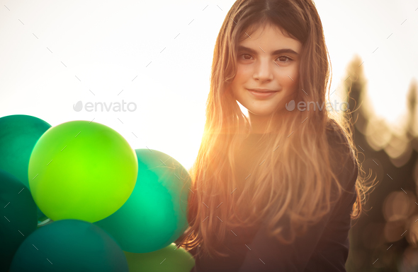 Cute girl with air balloons - Stock Photo - Images