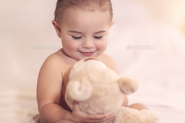 Cute baby with a bear - Stock Photo - Images