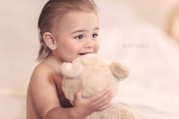 Little boy with soft toy - Stock Photo - Images