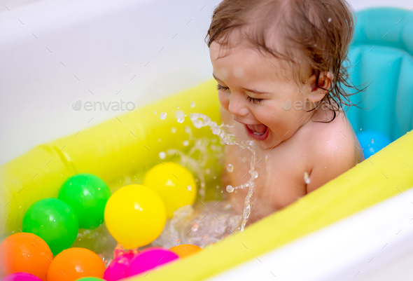 Happy boy bathing - Stock Photo - Images