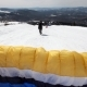 A Man Takes Off on a Paraglider in Winter. Running Through the Snow. Slow Motion - VideoHive Item for Sale