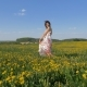 Happy Smiling Woman In Beautiful Dress Dancing In Blooming Yellow Field - VideoHive Item for Sale