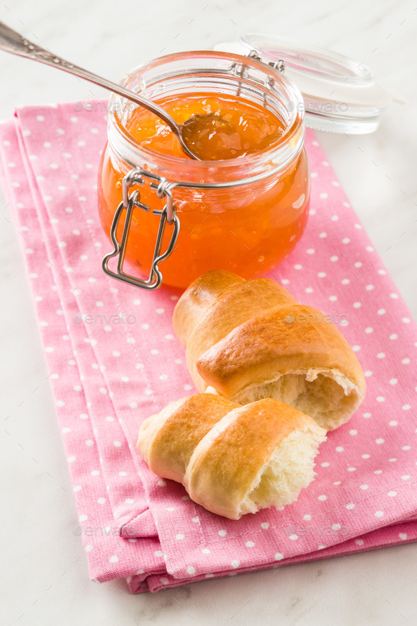 Apricot jam jelly and croissants. - Stock Photo - Images