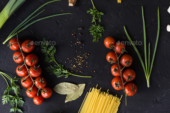 Fresh ingredients for cooking pasta, tomatoes, onions, garlic, herbs - Stock Photo - Images