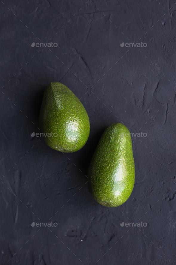 Avocado fruit on a black background - Stock Photo - Images