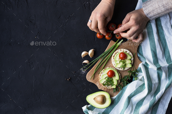 Vegan breakfast rice tortillas avocado tomato spices onions - Stock Photo - Images