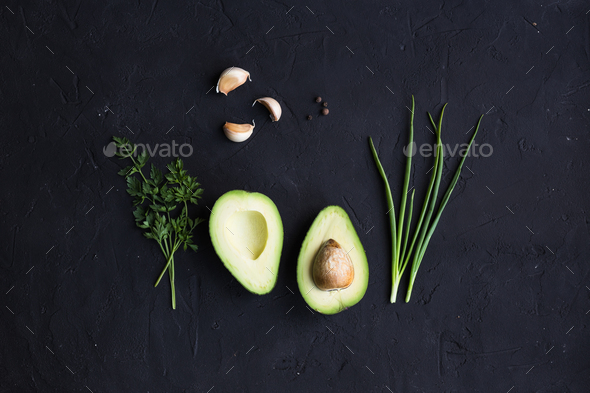 Avocado fruit on a black background - Stock Photo - Images