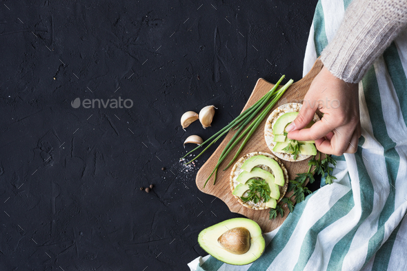 Vegan breakfast rice tortillas avocado tomato spices onions - Stock Photo - Images