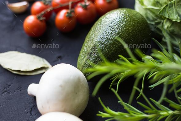 Fresh vegetables: cabbage, avocado, tomato, rosemary, garlic, mushrooms, leeks - Stock Photo - Images