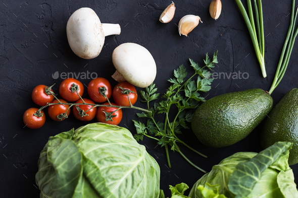Fresh vegetables: cabbage, avocado, tomato, rosemary, garlic, mushrooms, leeks - Stock Photo - Images