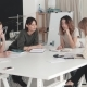 Fashion Designers in Small Business Startup Company Sit in the Atelier at Their Desk and Do Business