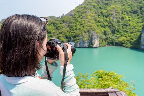 Woman tourist taking photos of Thale Nai - Stock Photo - Images