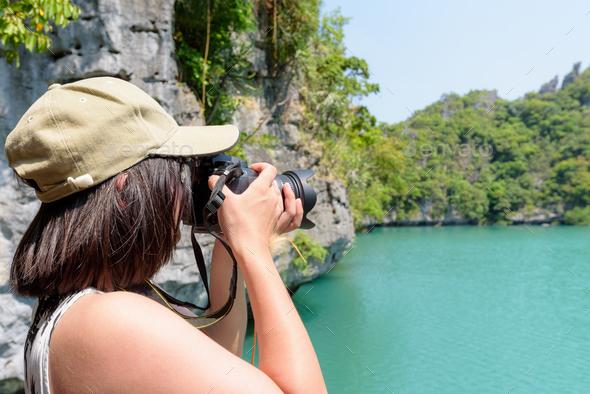Woman tourist taking photos Thale Nai - Stock Photo - Images