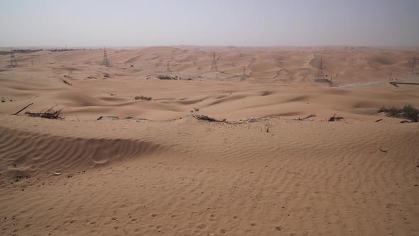 high voltage power lines in rub al khali desert united arab emirates