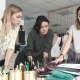 Business Women Are Engaged in Creative Work. Fashion Designers Work in Their Small Studio