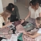 Fashion Designers Choose Fabrics for a New Collection of Clothes. a Group of Designers Works in a