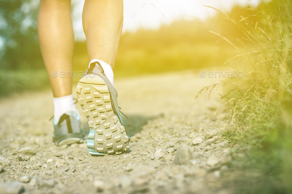Woman walking insports shoes, sport and fitness outdoors - Stock Photo - Images