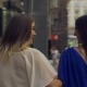Happy Shopping Women Walking Along City Street