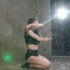 Wet Girl Dancer in Black Body Performs Contemporary Dance on the Floor in the Rain and Splashes - VideoHive Item for Sale