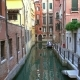Old Houses and Narrow Canal in Venice, Italy