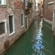Old Houses and Narrow Canal in Venice, Italy,