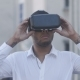 African American Young Businessman in White Shirt Using Helmet of Virtual Reality in the City - VideoHive Item for Sale