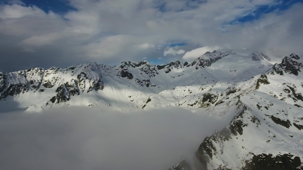 Snow-capped Mountains in Clouds