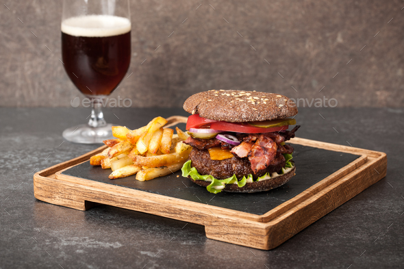 Burger, french fries and dark beer glass - Stock Photo - Images