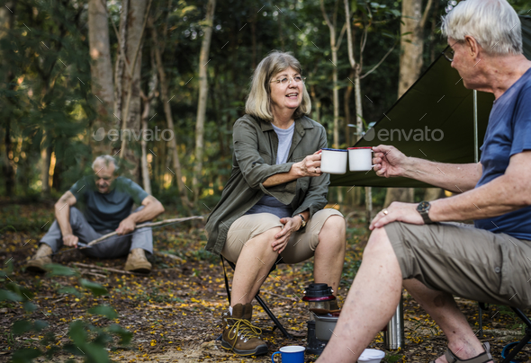 Friends having coffee at a campsite - Stock Photo - Images